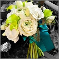 love the peacock feathers and silk flowers; not so psyched about the lime green calla lillies