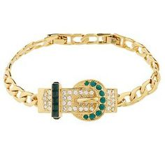 A gift from JFK, Jackie's gold buckle-style bracelet was set with 16 emeralds and 39 diamonds. She wore it on a trip to visit Queen Fredericka of Greece in 1961.