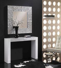Me encanta el espejo: http://www.desvandecor.com/espejo-plateado-espirales-p-2338.html
