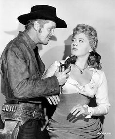 WINCHESTER '73 (1950) - Dan Duryea (as 'Waco' Johnny Dean) gives former saloon girl Shelley Winters some advice - Directed by Anthony Mann - Universal-International - Publicity Still.