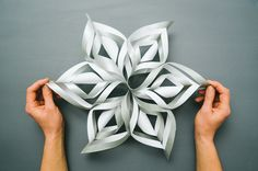 Want to impress your kids and spice up your window decor this season? Make 3-D snowflakes. C'mon, you know you want to.