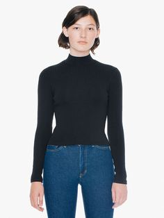 This mock turtleneck has long sleeves, a lightly ribbed texture and figure-hugging fit.