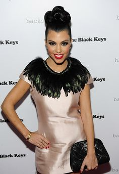 This is a big and bold, multilayered bun for an event for AG Adriano Goldschmied, and we cant imagine how long it took for Kourtney Kardashian!