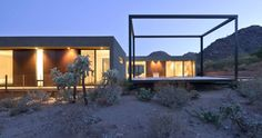 Three simple rectangular volumes hover above the desert floor, oriented to harness the sun, frame the views and capture the breezes. In much the same way a p...
