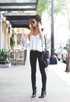 Black skinnies, black boots, and white tank.                                                                                                                                                      More