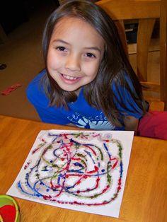 Salt painting. Glue, pour salt, use watercolor paint and watch the paint travel up the salt.