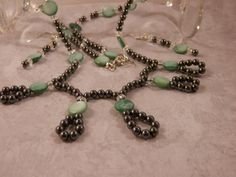 Mint Green Mother of Pearl, Hematite and Crystal Rondelle Beaded Necklace with Matching Earrings by TangledWireDesignsCo on Etsy