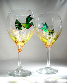 Custom personal Painted To Order Hummingbird Wine glasses hand designed and painted offering a personal Art on Glass presence to your table top decor. Each glass is designed with a blue-green hummingb