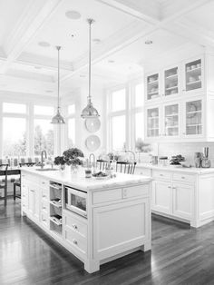 bright white kitchen, wood floors. http://www.bhg.com/decorating/storage/organization-basics/room-organization-tips/#page=8