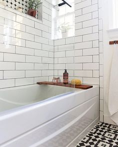Who wouldn't want to chill out in this crisp bath with the in stock Cambridge pattern on the floor and the classic white subway tile on the walls! #Repost @place_ofmy_taste ・・・ I am on vacation right now but I can't wait to get home and soak in my new tub😜 On the note: I think we made the best decision going with the large (4x12)subway tiles from @homedepot for our bathroom makeover!!🤘🏻 It's simple, clean, bright and beautiful!! ... and talk about pairing it with an awesome…