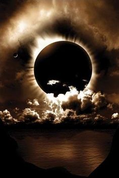 total eclipse...wow with those clouds.