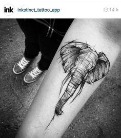 Elephant arm tattoo: