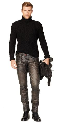 Tough guy. Pullover in black. Leather grey pants. Black boots.