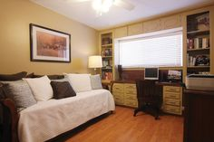 create a craft room and guest bedroom combo  | ... homes bedrooms is outfitted as a combination guest room and office