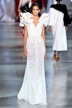 The Fall 2014 Couture runways were full of dresses and gowns to take your breath away. Peruse the best bridal-inspired looks straight from Paris.