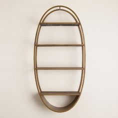 One of my favorite discoveries at WorldMarket.com: Oval Wood and Metal Wall Shelf