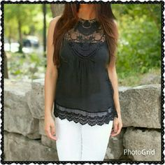 Black lace detailed tank top. This top is perfect for summer, and goes with everything. Lace on the shoulders, neckline and chest.  With a 2.5 inch band of lace around the bottom. 18 inches armpit to armpit.  24 inches from shoulder to hem. Boutique Chic  Tops Tank Tops