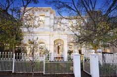 Grand and imposing double story balconied Victorian residence at 20 Darling Street, South Yarra