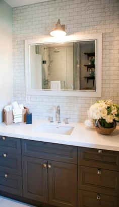 Bathroom. I love how much space on the vanity there is! The small decorations on it are neat, too.
