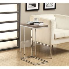 This sleek end table is made of polished chrome and features a reclaimed-look for a modern accent. With clean lines and a smooth finish, add a contemporary feel to your home with this charming table.
