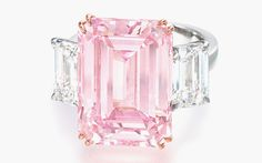 The Perfect Pink. A superb coloured diamond and diamond ring. Set with a rectangular-shaped fancy intense pink diamond weighing 14.23 carats, flanked on either side by a rectangular-shaped diamond weighing 1.73 and 1.67 carats, mounted in 18k rose and white gold. Sold for: HK$179,860,000 ($23,274,064) on 29 November 2010 at Christie's in Hong Kong
