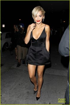 rita ora shows cleavage after calvin harris split 01 Rita Ora keeps it sexy in a black little dress while enjoying a night out at Bootsy Bellows on Friday (June 6) in West Hollywood, Calif.