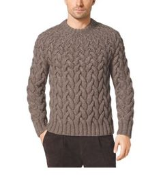 """""""It's all about looking polished, sleek, successful, but at the same time wearing clothes that are comfortable, versatile and travel well,"""" says Michael. An ascending cable knit imparts this wool-blend sweater with thoughtful design, while the ribbed crewneck, cuffs and hem lend classic character. We especially love it with suede track pants and leather boots for a tasteful texture contrast."""