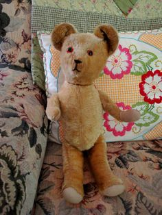 Melissa's mom's bear after being restored by Dot Bird - new arm, new eyes, new foot pads, ears, nose and shoulder repaired and new wood wool