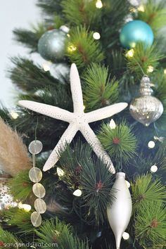 Coastal ornaments adorn the Balsam Hill Scotch Pine. Via @Sand and Sisal #ChristmasInJuly