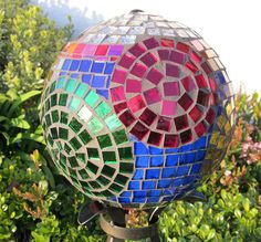 wHAT ABOUT A RAISED PLANTER BED OR YARD EDGING MADE OF MOSAIC'ED BOWLING BALLS OR BOULDERS?