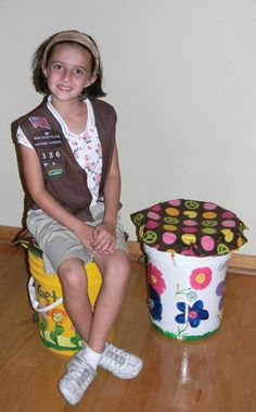 ...camping pails for daughter's Girl Scout Brownie troop. The girls painted on 5-gallon pickle buckets that were donated by a local restaurant, painted their names and troop number on the lids. Each girl made a cushion to go on top of her pail for sitting on. The carryalls are a great way to keep all their belongings together and dry at the same time.-- Barbara Moseley.  fb- familyfun.com