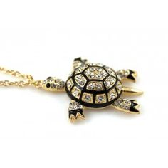 Inspired by the ocean is this cute turtle pendent with crystal studs on gold and black metal.  Turtle measures 5cm and necklace 81cm long with lobster clasp closure.