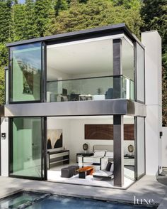 Modern LA home boasts remarkable indoor-outdoor lifestyle by Belzberg Architects offering sweeping canyon views over the Hollywood Hills in Los Angeles, California.
