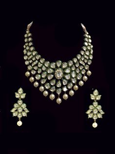 Classic green enamel Polki diamond south sea pearl gold necklace and earrings. @Umrao Jewels