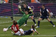 United States goalkeeper Hope Solo makes a save against Japan during the women's soccer gold medal match at the 2012 Summer Olympics, Thursday, Aug. 9, 2012, in London.