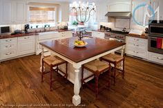 Red Ravel provides stark contrast against the white cabinets on both main counters as well as the island.
