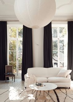 Monochrome living space with a large paper lantern