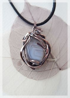 Gray agate pendant. This is a small beautiful piece of agate which has been wire-wrappered into a ooak pendant. Elegant and graceful gift idea for woman