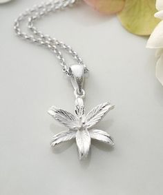 This Sterling Silver Lily Flower Star Pendant Necklace is perfect! #zulilyfinds
