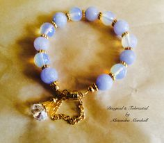 """This stunning blue chalcedony and moonstone 7"""" bracelet by Alexandra Marshall has 18k gold overlay components, a crystal charm, magnetic clasp & safety chain. #B2236. $49. Double click photo to order."""
