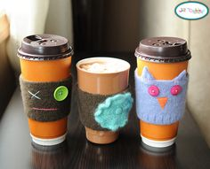 This blog is fantastic!  This idea is to use wool sweaters, felt them, and make cup cozies (like Starbucks paper sleeves, only CUTE!)  TOO FUN!