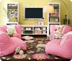 Kids TV room. Love the shelves and chairs!!