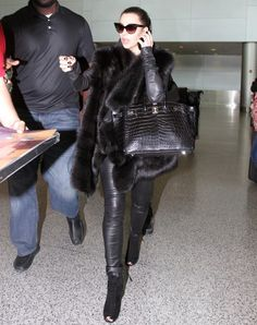 Kim Kardashian wearing Tom Ford sunnies, J Brand pencil leggings, an Hermes Birkin bag in black croc, & Tom Ford Fall 2011 ankle boots.