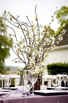 Love these floral branch centerpieces {In The Now Weddings and Events}