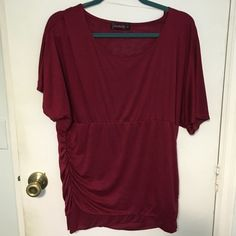 Wine colored top Like new wine colored top with round neck, short sleeves and more fitted rouched bottom. Size 2x very flattering.  Bundle items from my closet and save %!! Annabelle Tops Blouses
