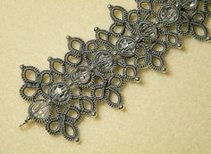 ENGLISH LANGUAGE, with a lot of photos step by step  Material requirements: 3mm silver beads and 8mm Swarovski beads After notification of sale and payment the PDF will be available for download  It is best if you would have at least some previous knowledge and experience working with tatting   For other of my patterns , visit http://happylandblogpattern.blogspot.it/  PER LO SCHEMA IN ITALIANO scrivere a claudia@happyland.it