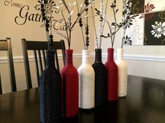 simple wine bottle centerpieces | Yarn-wrapped bottles from Living Unbound
