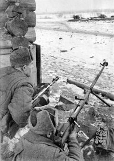 Tula working Regement Soldiers defending their hometown with a Soviet anti-tank gun 14.5 mm PTRD-41 submachine gun PPSH-41