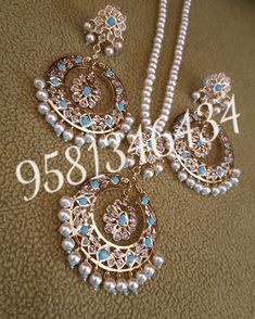 Gold plated pendantset handfitted with blue stone and pearl To order,watsap or call 9581346434 Shipping worldwide COD to limited cities Pearl Jewelry, Bridal Jewelry, Nizam Jewellery, Ruby Necklace, Earrings, Hyderabadi Jewelry, Jhumar, Multi Coloured Necklaces, Pearl Set