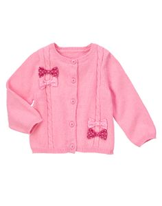 Cozy cute for chilly days. Cable knit button-up cardigan is always soft - with cute polka dot bows for extra adorableness. (Gymboree 0-24m)